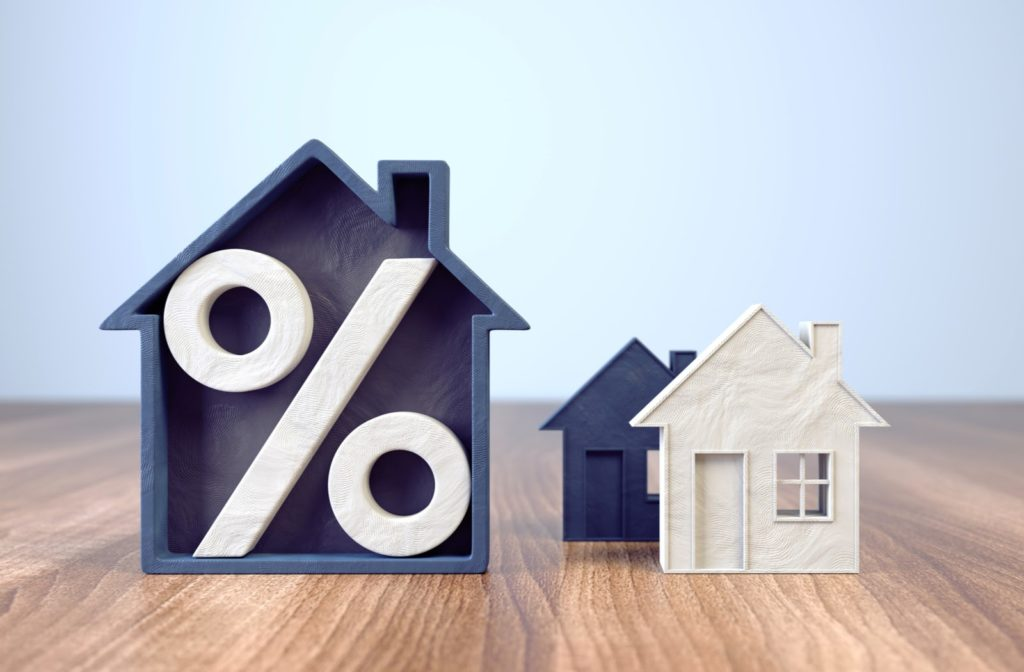 An illustration of a house with a percentage sign inside highlighting mortgage rate