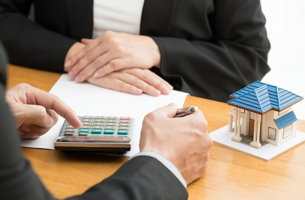 A mortgage broker assisting in refinancing someone's mortgage